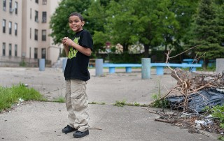 A young boy, Jacob, plays in an abandoned playground in Hunts Point, Bronx. Photo: MIT CoLab Radio