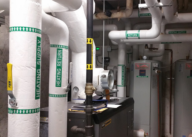 A new energy efficient heating system was installed in a multi-family building as part of NWBCCC's Weatherization Assistance Program for low-income families. Photo: Northwest Bronx Community and Clergy Coalition