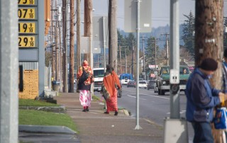 Pedestrians walk east along Southeast Division Street, one of the five-lane arterials that runs through East Portland. Photo: The Oregonian