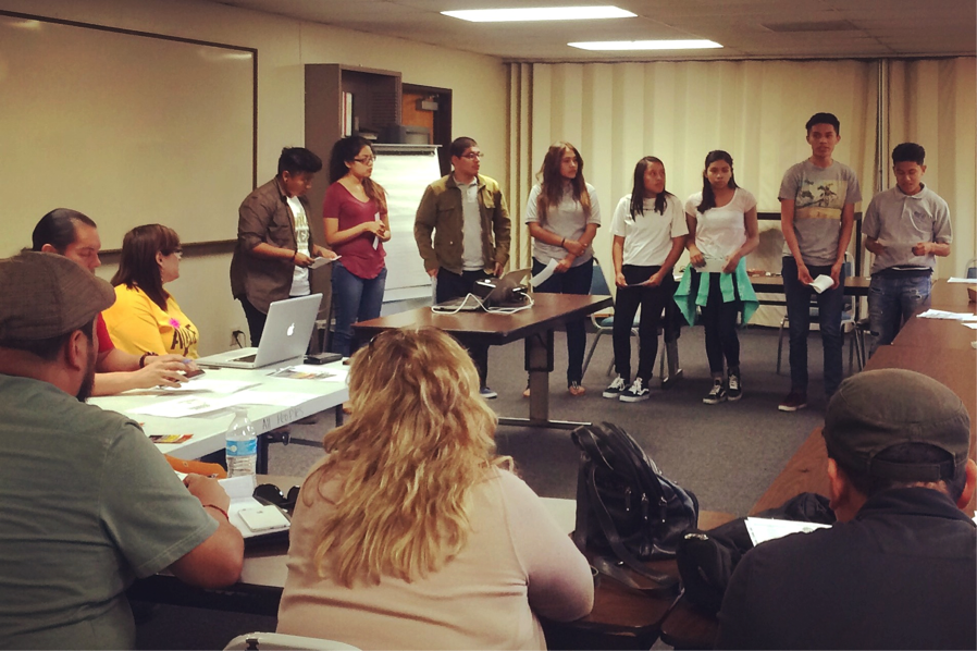 Los Angeles Community Liaisons speak to a group
