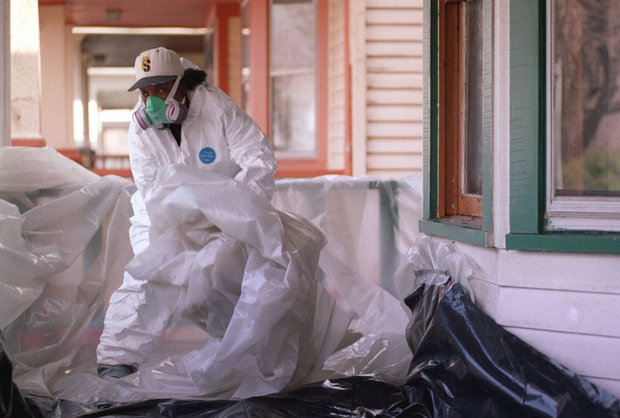 A lead paint abatement specialist works on a home in Cleveland in this photo from 2000. Cleveland health department officials said Wednesday that if a city income tax increase passes, the department will hire three more lead investigators. (Plain Dealer file photo)