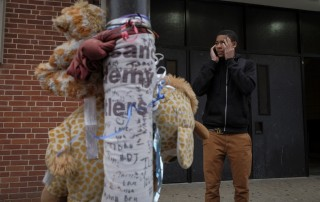 Khalil stands beside a memorial to Jolley outside their West Baltimore high school.